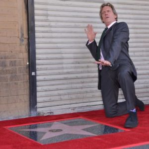 488286-hugh-laurie-poses-with-his-star